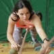 Young Woman Is on Climbing Wall in Motionless State in Sports Club. - VideoHive Item for Sale