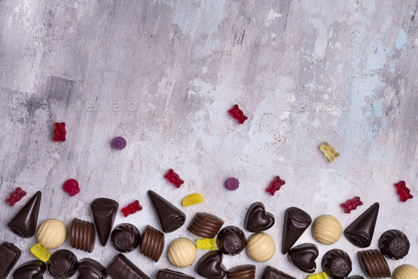 Border of photos assortment of chocolate candies - Stock Photo - Images