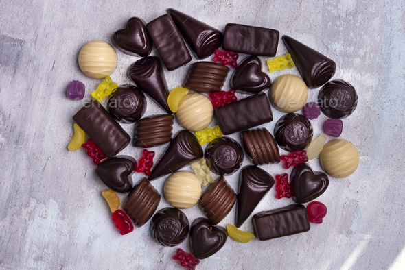 various chocolate pralines isolated on stone background - Stock Photo - Images