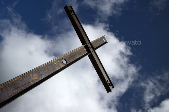 Iron cross and cloudy sky - Stock Photo - Images