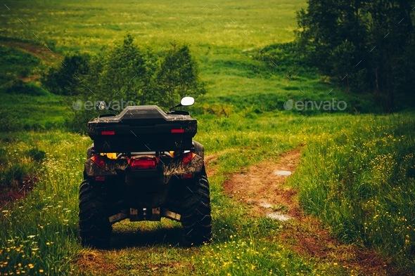 ATV Quad Bike in wild nature landscape - Stock Photo - Images