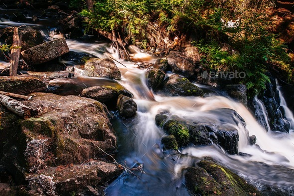 Fast river flowing water of waterfall in Finland - Stock Photo - Images