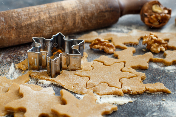 Cooking Christmas cookies with  cookie cutters - Stock Photo - Images