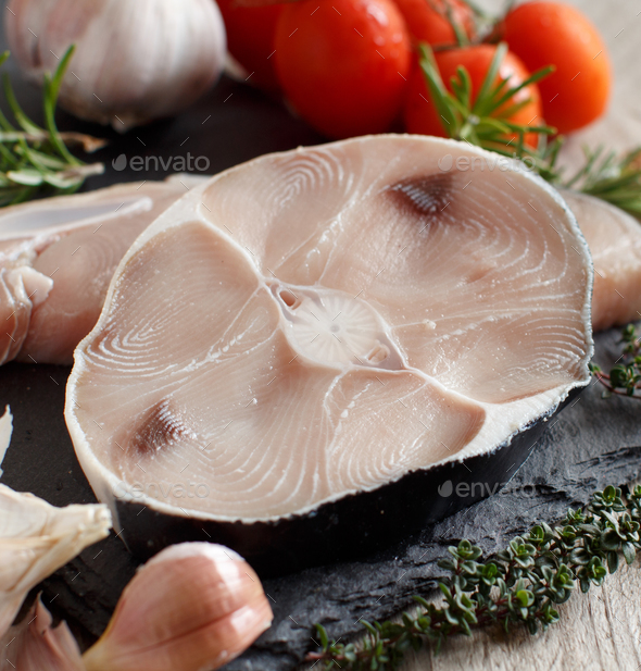 Two shark steak with vegetables and herbs - Stock Photo - Images