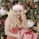 Portrait of Sexy Female Santa Holding Gift Near the Christmas Tree, . - VideoHive Item for Sale