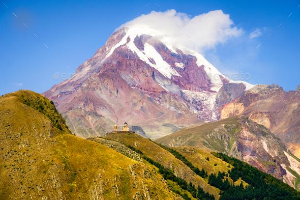 Landscape view of Kazbeg mountain and Tsminda sameba church, Geo - Stock Photo - Images