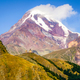 Landscape view of Kazbeg mountain and Tsminda sameba church, Geo - PhotoDune Item for Sale