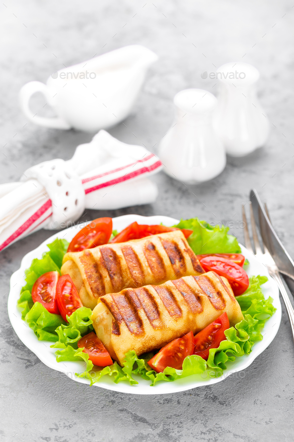 Pancakes. Pancakes stuffed on plate. Wrapped pancakes - Stock Photo - Images