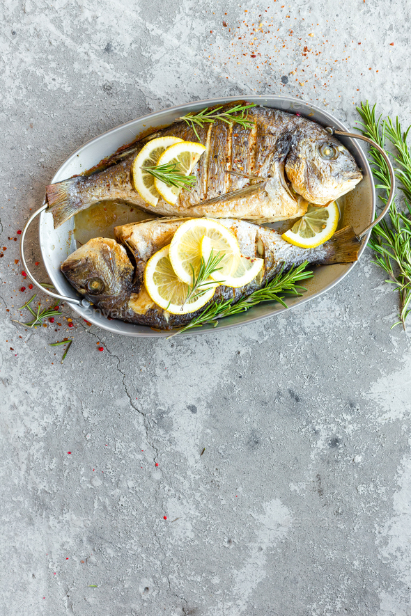 Baked fish dorado. Sea bream or dorada fish grilled - Stock Photo - Images