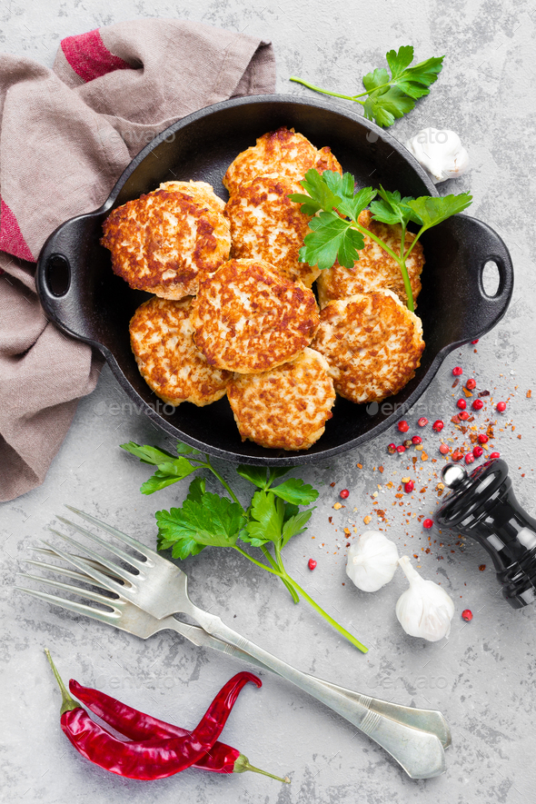 Cutlets. Fried cutlets in cast-iron pan on table - Stock Photo - Images