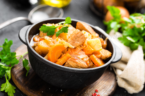 Meat stew with vegetables. Braised meat with cabbage, carrot and potato - Stock Photo - Images