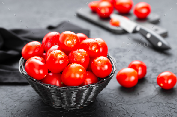 Tomatoes. Fresh tomatoes in basket on table - Stock Photo - Images