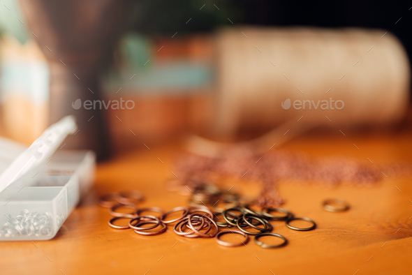 Metal rings on wooden table, closeup, needlework - Stock Photo - Images