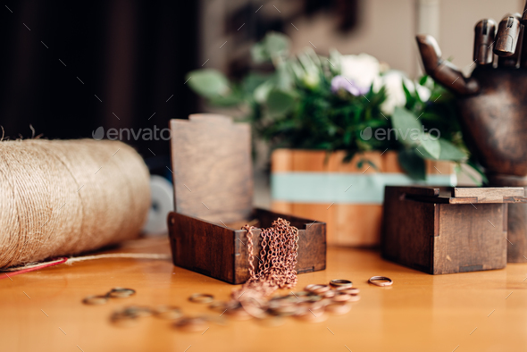 Needlework, metal rings and wooden box on table - Stock Photo - Images