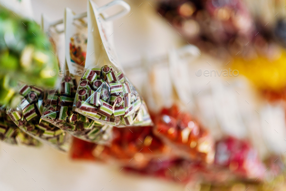 Colorful caramel sweets in transparent bags - Stock Photo - Images