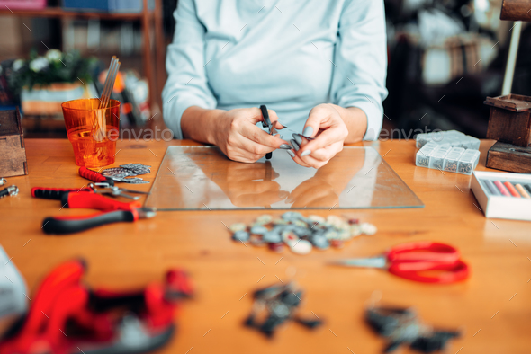Female hands with scissors, handmade jewelry - Stock Photo - Images