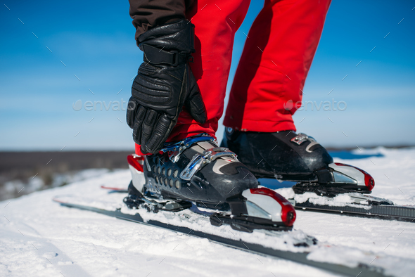 Skier hand fastens the fastening of skis closeup - Stock Photo - Images