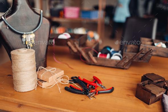 Needlework equipment, pliers, workshop interior - Stock Photo - Images
