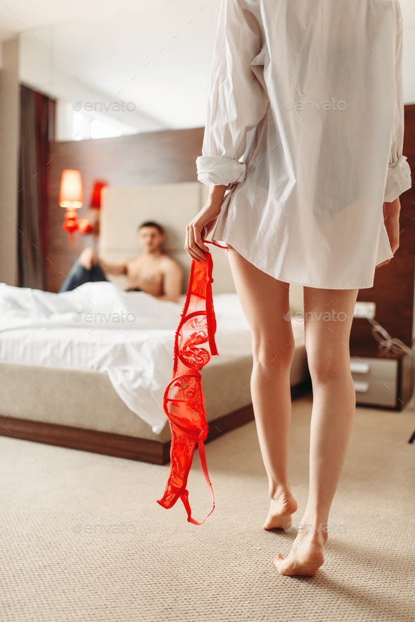 Sexy female with red bra in hand, itimate couple - Stock Photo - Images