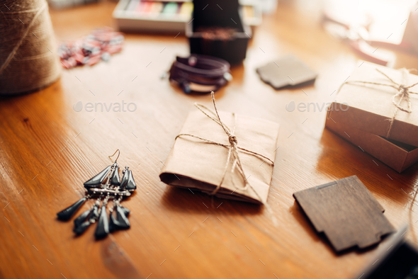 Gift box and handmade earrings on wooden table - Stock Photo - Images