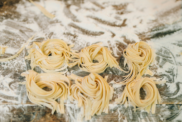 Uncooked homemade fettuccine closeup, nobody - Stock Photo - Images