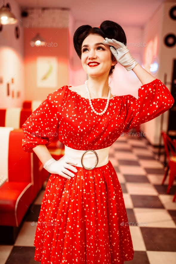 Pinup woman in retro cafe with checkerboard floor - Stock Photo - Images