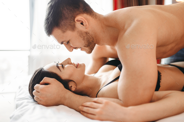 Games of intimate partners in bedroom, hot lovers - Stock Photo - Images
