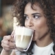 Beautiful Hispanic Woman Enjoys the Latte in a Cozy Cafe - VideoHive Item for Sale