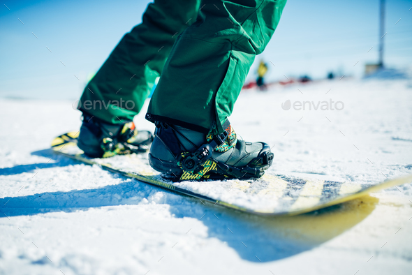 Snowboarder riding a snow hill, extreme sport - Stock Photo - Images