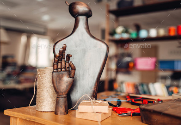 Needlework accessories, wooden hand and mannequin - Stock Photo - Images
