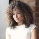 Portrait of a Attractive Hispanic Girl with a Beautiful Smile. Young Mulatto Woman with Curls in a - VideoHive Item for Sale