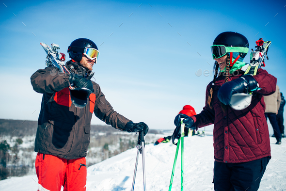 Male and female skiers poses with skis and poles - Stock Photo - Images