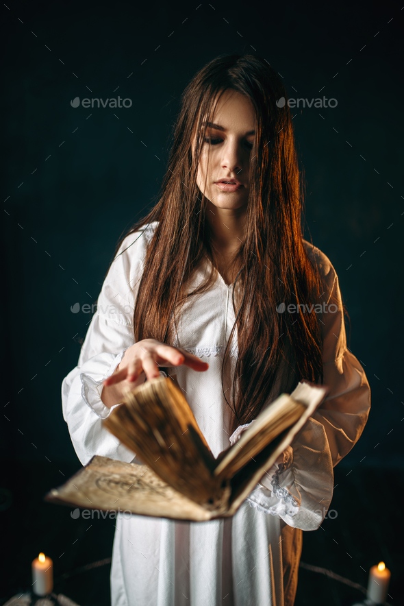 Woman sitting in the center of pentagram circle - Stock Photo - Images
