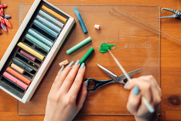 Female person works with polymer clay, top view - Stock Photo - Images