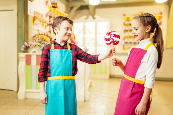 Boy gives handmade lollipop to his girlfriend - Stock Photo - Images