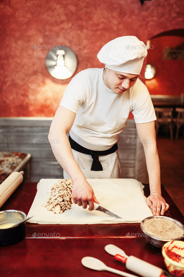 Male chef prepares apple strudel - Stock Photo - Images