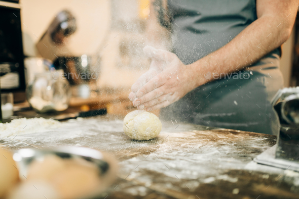 Fresh pasta cooking, chef hands with dough - Stock Photo - Images
