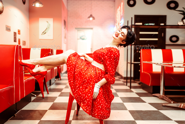 Sexy pin up girl with makeup posing in retro cafe - Stock Photo - Images