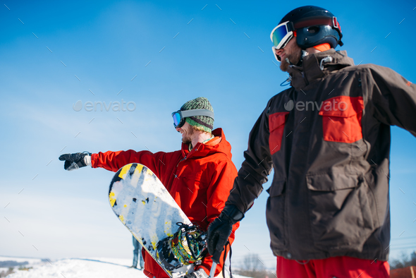 Snowboarder and skier poses on the top of mountain - Stock Photo - Images