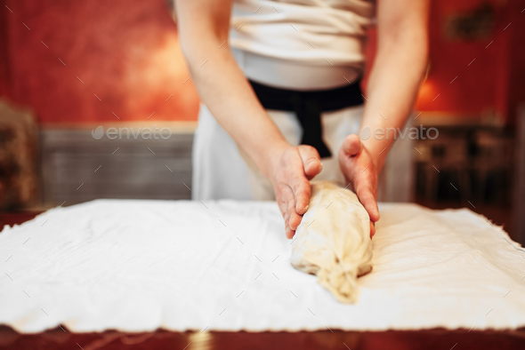 Chef prepares classic apple strudel for baking - Stock Photo - Images