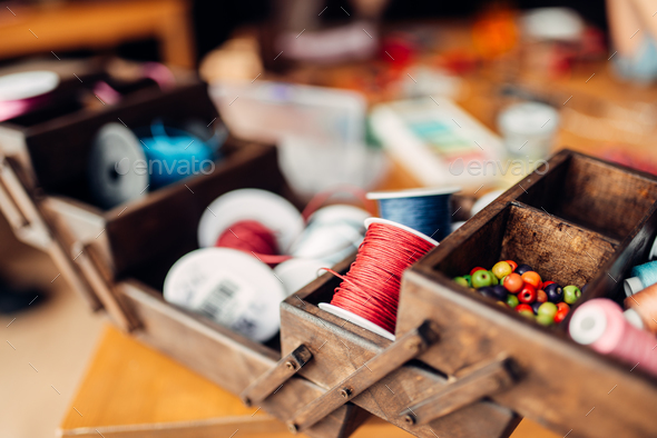 Needlework, box with ropes, beads and accessories - Stock Photo - Images