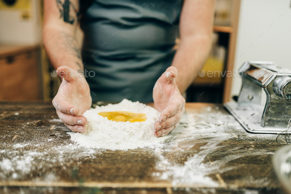 Pasta cooking, bearded chef preparing dough - Stock Photo - Images