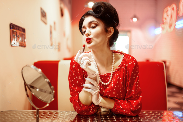 Sexy pin up woman with bright lipstick in hand - Stock Photo - Images