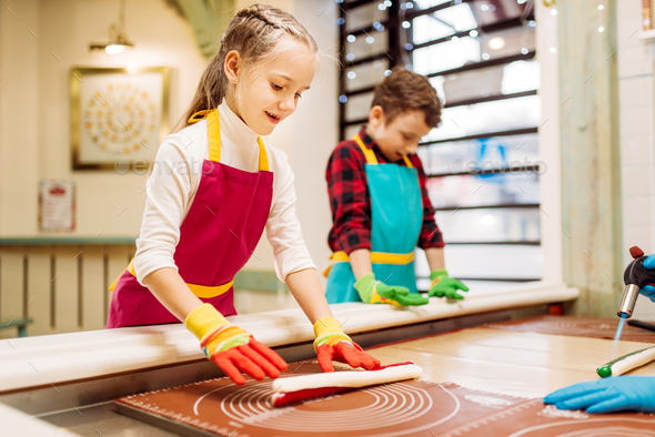 Little girl and boy learn to make caramel - Stock Photo - Images