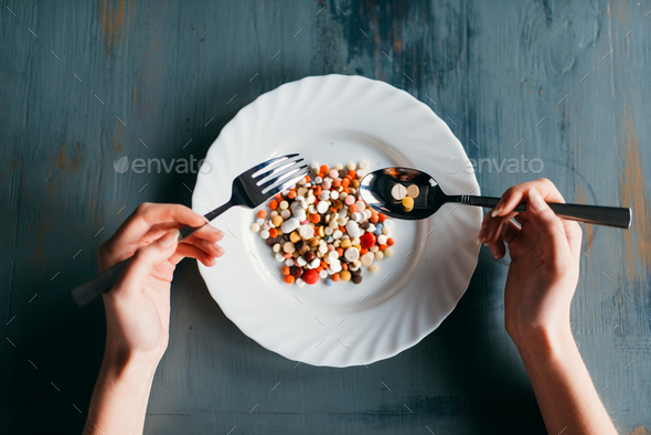 Plate full of drugs, weight loss diet concept - Stock Photo - Images