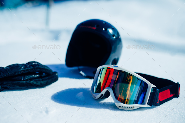 Helmet, glasses and gloves on the snow closeup - Stock Photo - Images