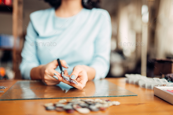 Female hands with scissors, handmade jewelry - Stock Photo - Images