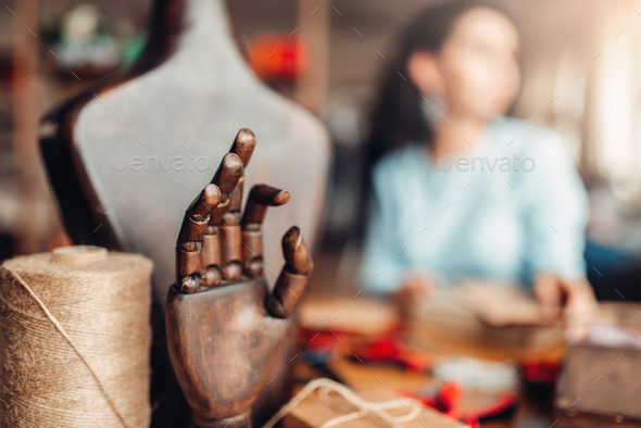 Needlework tools, wooden hand and mannequin, - Stock Photo - Images