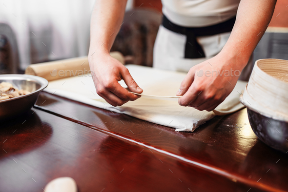 Male chef cooking apple strudel - Stock Photo - Images