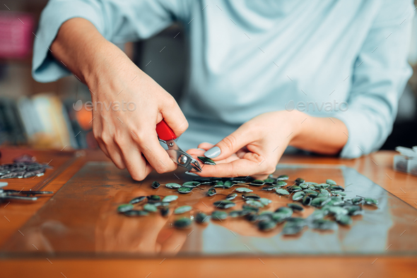 Female person hands with pliers, handmade jewelry - Stock Photo - Images